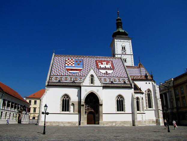 St. Mark's Church in Zagreb is located on St. Mark's Square, where also the Parliament Building (can be seen in the right).